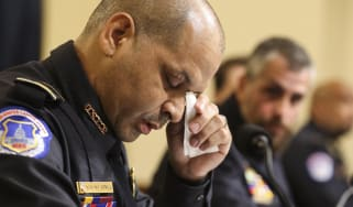 Capitol Police Sergeant Aquilino Gonell wipes away tear while giving evidence