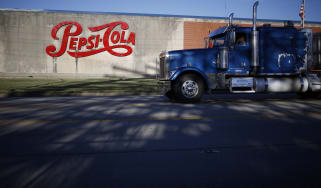 A truck passes in front of a PepsiCo Inc. facility in Louisville, Kentucky, U.S., on Tuesday, Sept. 24, 2019. PepsiCo Inc. is scheduled to release earnings figures on October 3. Photographer: