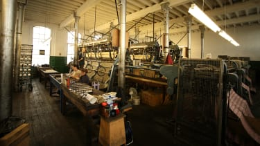 The industrial machines in action at the Cluny Lace factory