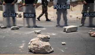 Rocks thrown at police during a peasants protest demanding a higher salary in Ica, Peru.