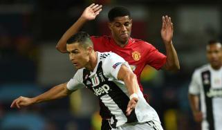 Juventus striker Cristiano Ronaldo battles with Manchester United's Marcus Rashford