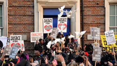 Doves are released outside Tottenham Police Station