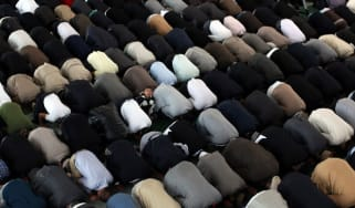 LONDON, ENGLAND - SEPTEMBER 21:Muslim men pray after a speach by the Islamic Khalifa of the Ahmadiyya Muslim community Mirza Masroor Ahmad at Baitul Futuh Mosque in Morden on September 21, 20