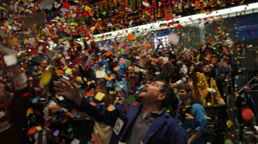 CHICAGO - DECEMBER 31:Traders and clerks in the Eurodollar trading pit at the CME Group's Chicago Board of Trade celebrate as confetti falls signaling the end of the trading year December 31,
