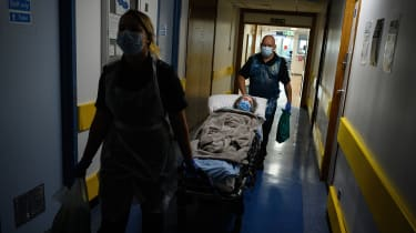 Patient transport services move an elderly patient from hospital to a care home.