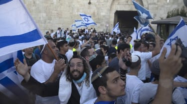 Israelis ultranationalists march through the Old City.