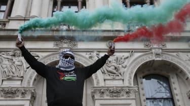 A pro-Palestinian demonstrator outside Downing Street