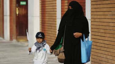 A mother and child outside an East London Mosque