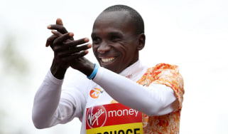 Kenyan athlete Eliud Kipchoge celebrates his victory in the men's elite race at the 2019 London Marathon