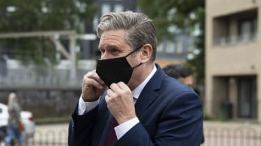 Keir Starmer wearing a black face mask.