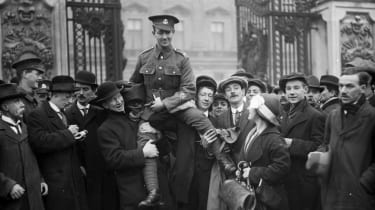 29th November 1916:Private Ryden, VC is lifted aloft on the shoulders of his friends after being invested with the Victoria Cross at Buckingham Palace, London.(Photo by Topical Press Agency/G