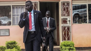 Human rights lawyer Nicholas Opiyo leaves a police station after meeting with minister Simon Lokodo