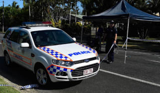 Police at the stabbing scene in the suburb of Manoora in Cairns, Australia.