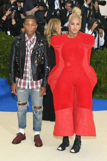 """NEW YORK, NY - MAY 01: Pharrell Williams and Helen Lasichanh attends the """"Rei Kawakubo/Comme des Garcons: Art Of The In-Between"""" Costume Institute Gala at Metropolitan Museum of Art on May 1,"""
