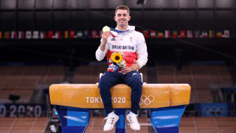 Team GB's Max Whitlock poses with his gold medal