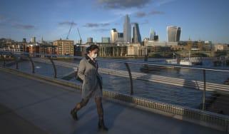 A masked pedestrian in London