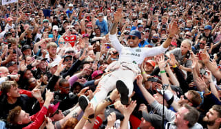 Lewis Hamilton celebrates with fans after winning the 2016 British Grand Prix at Silverstone