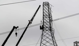 Workers struggle to restore power to Puerto Rico following Hurricane Maria