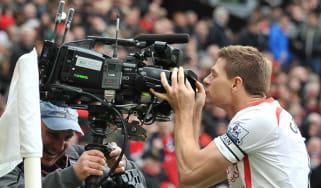 Steven Gerrard kisses a television camera