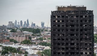 The City of London skyline seen behind the remains of Grenfell Tower