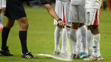 A referee uses the spray during a World Cup match