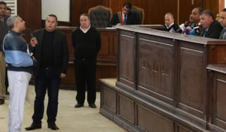 Al-Jazeera English journalist Egyptian-Canadian Mohamed Fahmy adresses the judge at the courtroom in Cairo