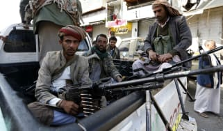 Huthi rebels in front of the residence of Yemen's former president Ali Abdullah Saleh in Sanaa.