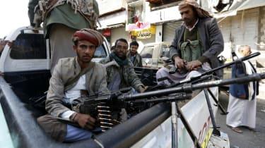 Huthi rebels in front of the residence of Yemen's former president Ali Abdullah Saleh in Sanaa.
