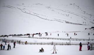 Skiers and snowboarders enjoy the slopes at Glenshee Ski Centre