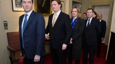 LONDON, ENGLAND - MARCH 19:Chancellor of the Exchequer George Osborne and Chief Secretary to the Treasury Danny Alexander prepares to lead members of the Treasury team out of 11 Downing Stree