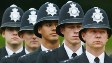 Officers stand to attention during the Metropoitan Police Service's 175th Anniversary