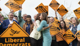 BRECON, UNITED KINGDOM - AUGUST 02: By-election victor and Welsh Lib Dem leader Jane Dodds MP (L) hugs Lib Dem leader Jo Swinson MP at a photocall to celebrate the victory in the Garden of th