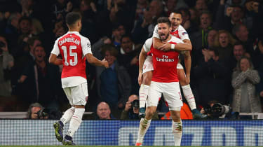 Olivier Giroud of Arsenal with Alex Oxlade-Chamberlain and Alexis Sanchez