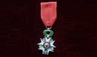 A picture taken on March 30, 2015 in Parois shows the medal of Chevalier of the Legion of Honor.AFP PHOTO /JACQUES DEMARTHON(Photo credit should read JACQUES DEMARTHON/AFP via Getty Images)