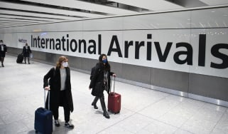 Airline passengers arrive at Heathrow Airport in London