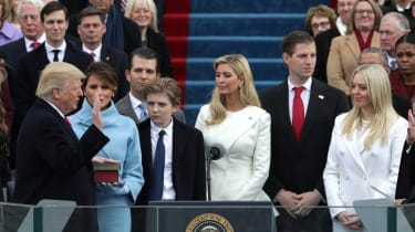 Donald Trump takes the oath of office from Supreme Court Chief Justice John Roberts.