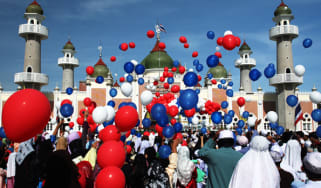 Thai Muslims release hundred of balloons after a morning prayer marking the start of the Islamic feast of Eid al-fitr