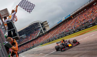 Red Bull's Dutch driver Max Verstappen won the chaotic F1 German Grand Prix on 28 July