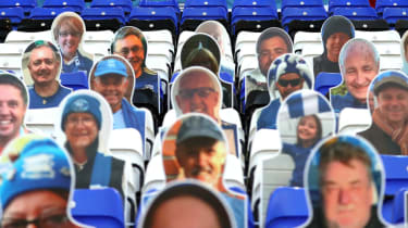 Cardboard cutouts of football fans at St Andrew's stadium in Birmingham