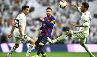 Barcelona's Lionel Messi in action against Real Madrid's Sergio Reguilon and Sergio Ramos