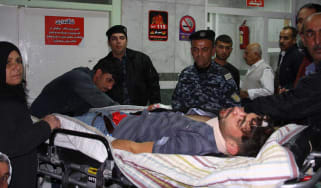 An injured man receives treatment in hospital following deadly earthquake