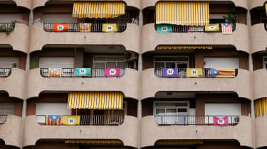 An apartment block bedecked with Catalan flags and pro-independence banners in Barcelona