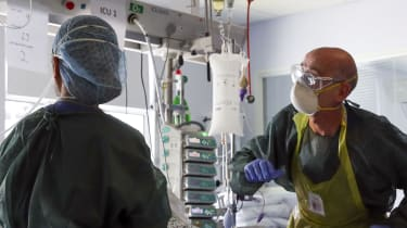 NHS staff treat a Covid patient in intensive care at Frimley Park Hospital, Surrey
