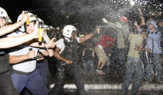 Police spray demonstrators with pepper gas during a student protest at National Congress in Brasilia, on June 20, 2013 within what is now called the 'Tropical Spring' against corruption and p