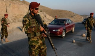 Afghan soldiers keep watch at a checkpoint in Nangarhar province