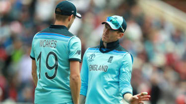 England skipper Eoin Morgan talks to Chris Woakes during the World Cup loss against Pakistan