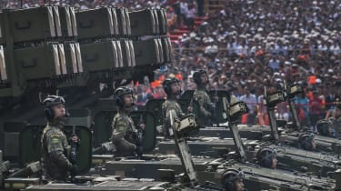 Chinese troops on mobile rocket launchers during a parade in Beijing