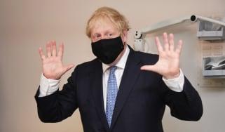 Boris Johnson wearing a mask