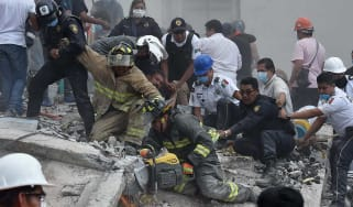 Rescue workers and residents team up to search for survivors in Mexico City
