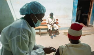 A nurse gives a Covid vaccination in Harare, Zimbabwe